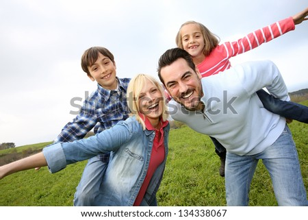 Portrait of happy family in countryside - stock photo