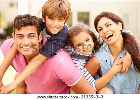 Portrait Of Happy Family In Garden At Home - stock photo