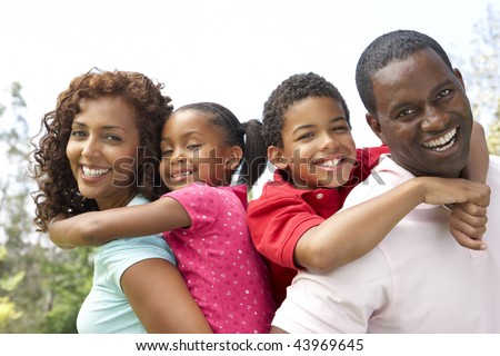 Portrait of Happy Family In Park - stock photo