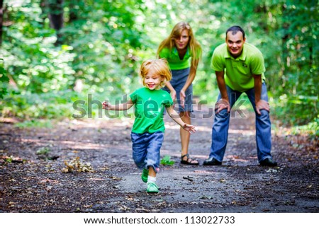 Portrait of Happy Family In Park - outdoor shot - stock photo
