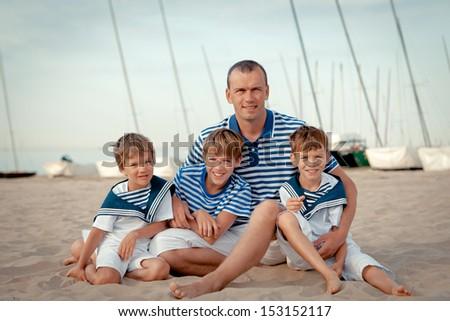 Portrait of happy family near yacht, outdoor - stock photo