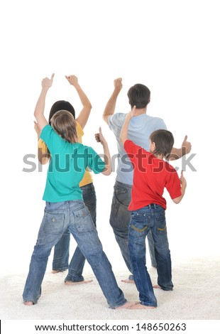 portrait of happy family of four from the back - stock photo