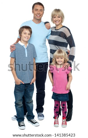 Portrait of happy family of four on white background - stock photo
