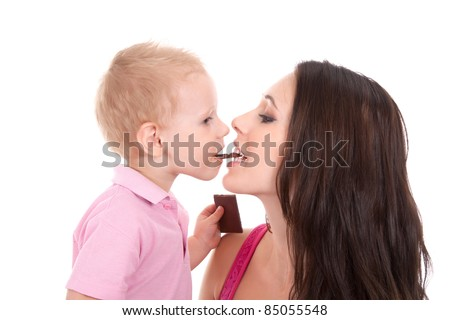 Portrait of happy family of son and his mother eating chocolate bar together isolated on white background - stock photo