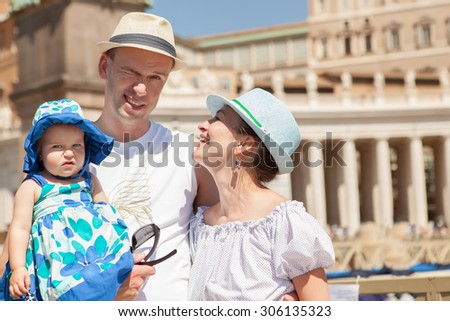Portrait of happy family on background of city, outdoors - stock photo