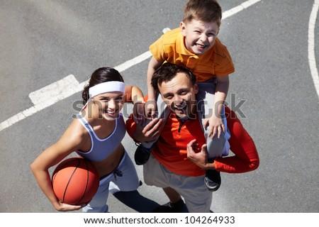 Portrait of happy family on playground - stock photo
