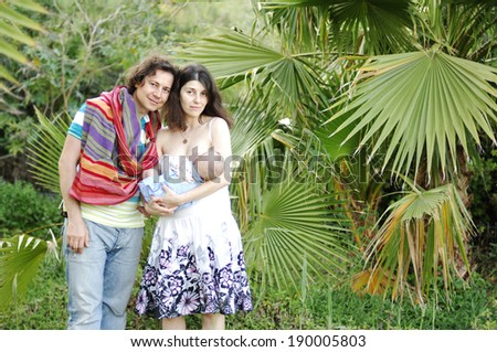 Portrait of happy family outdoor - stock photo