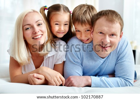 Portrait of happy family resting at home - stock photo