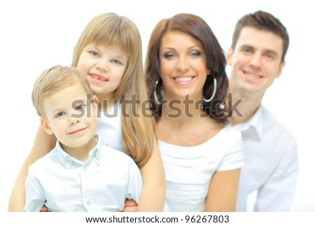 Portrait of happy family smiling at the camera - stock photo