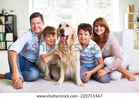 Portrait of happy family spending weekend at home - stock photo