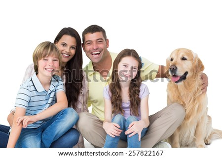 Portrait of happy family with golden retriever against white background - stock photo