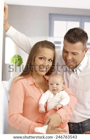 Portrait of happy family with newborn baby. - stock photo