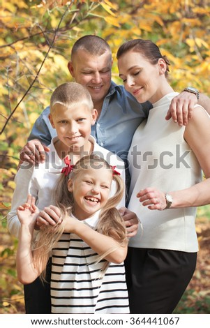 Portrait of happy family with two children, outdoor - stock photo