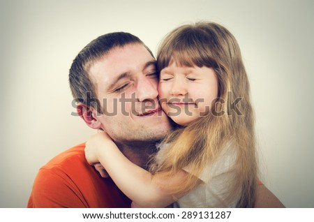 Portrait of happy father and daughter - stock photo