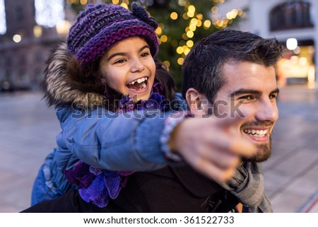Portrait of happy father and daughter having fun in the street. - stock photo