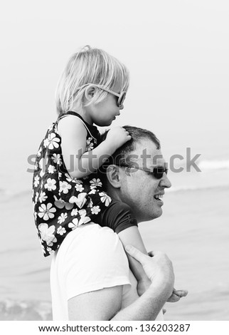 Portrait of happy father and his adorable little daughter - stock photo