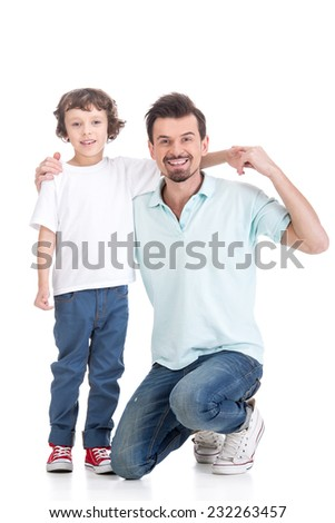 Portrait of happy father and his handsome  son, on the white background. - stock photo