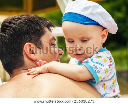 Portrait of  happy father with a baby  - stock photo