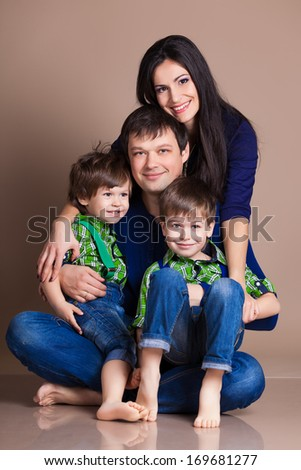 Portrait of happy fun beautiful family with two children - stock photo