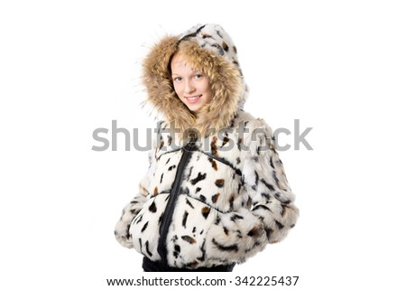 Portrait of happy funny beautiful casual teenage girl wearing winter coat with hood, holding hands in pockets, looking at camera with cheerful expression, studio image, white background - stock photo