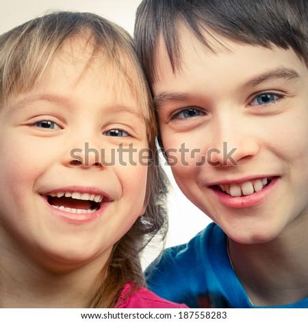 Portrait of happy girl and boy - stock photo