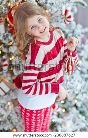 Portrait of happy girl decorating Christmas tree - stock photo