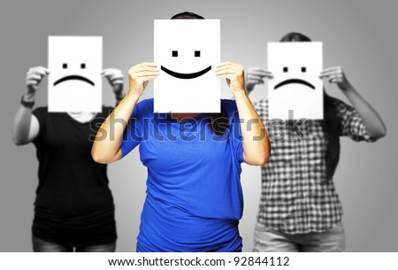 portrait of happy girl in front of two sad girls - stock photo