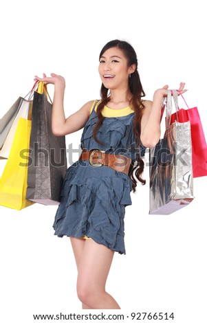 Portrait of happy girl shopping over white background - stock photo