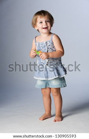 Portrait of happy girl standing with dress jeans. - stock photo
