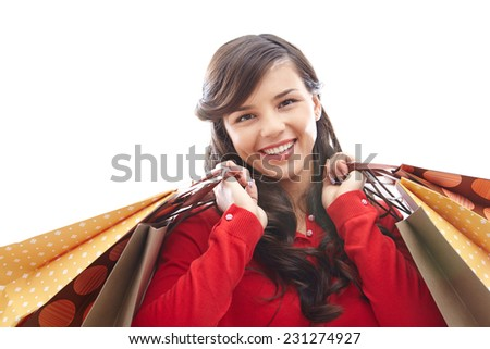 Portrait of happy girl with shopping bags looking at camera  - stock photo