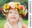 Portrait of Happy girl with wreath from Flowers  at Summer. Happy Children - stock photo