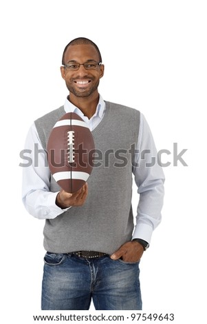 Portrait of happy guy laughing, posing with American football, isolated on white. - stock photo