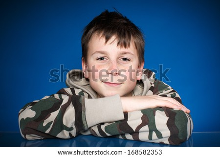 Portrait of happy guy on a blue background - stock photo