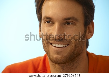 Portrait of happy handsome casual caucasian man with stubble. Smiling, perfect teeth, copyspace. - stock photo