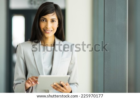 portrait of happy indian career woman using tablet pc - stock photo