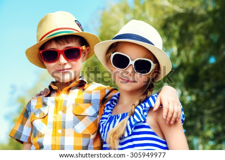 Portrait of happy kids on a bright sunny day. Friendship. Summer holidays.  - stock photo