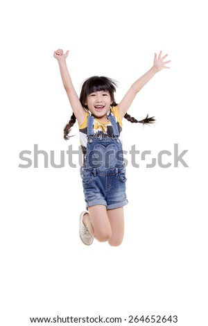 Portrait of happy little Asian child jumping isolated on white  - stock photo