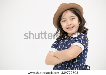 Portrait of happy little Asian child smiling on isolated background - stock photo