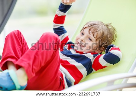 Portrait of happy little boy in red clothes. - stock photo