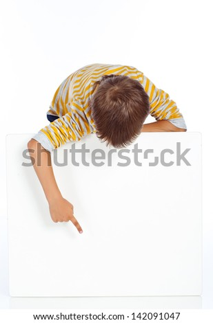 Portrait of happy little boy with white blank isolated on white background - stock photo