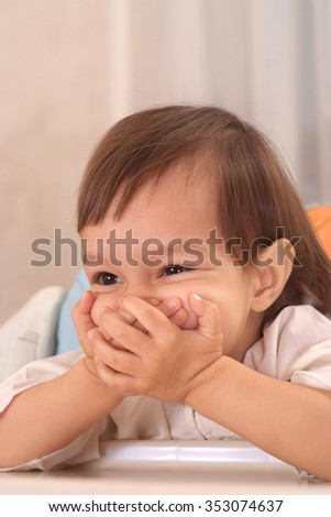 Portrait of  happy little girl at home - stock photo