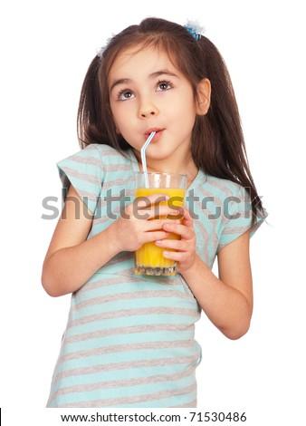 Portrait of happy little girl drinking orange juice - stock photo