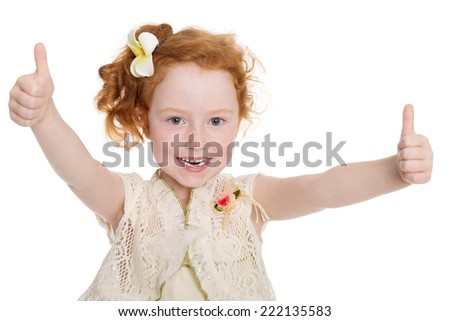 Portrait of happy little girl gesturing thumbs up.Girl is six years. - stock photo
