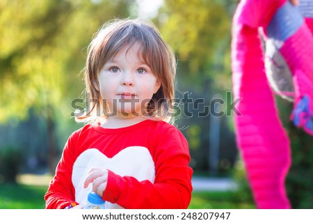 Portrait of happy little girl in the park. - stock photo