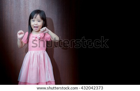 Portrait of happy little girl showing two hands - stock photo