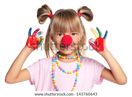 Portrait of happy little girl with red clown nose isolated on white background - stock photo