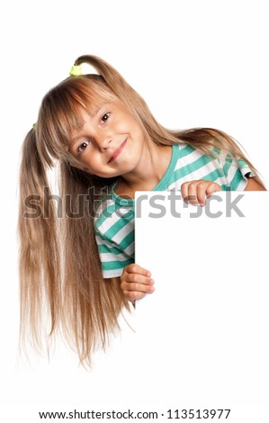 Portrait of happy little girl with white blank isolated on white background - stock photo