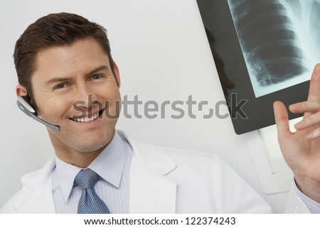 Portrait of happy male doctor gesturing - stock photo