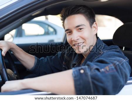 Portrait of happy male driver - stock photo