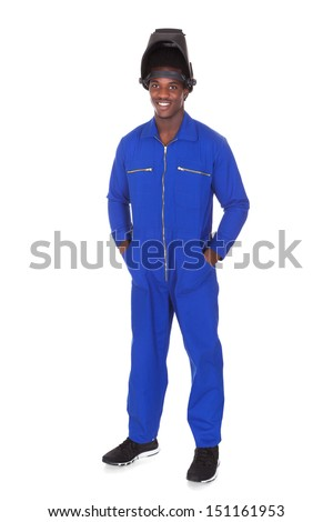 Portrait Of Happy Male Welder Standing Over White Background - stock photo